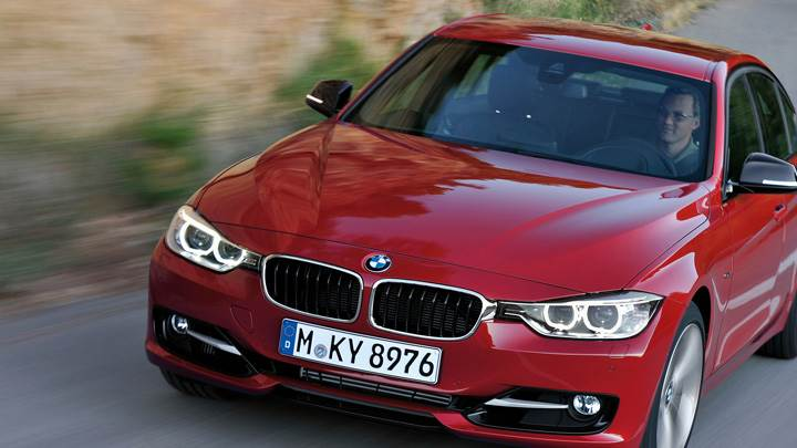 Running Front Pose Of BMW 3 Series Sedan F30 in Red